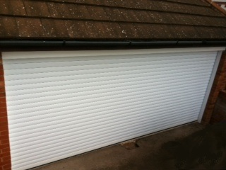 Double roller style garage door in cornwall image take in Newquay by Newquay Plastics