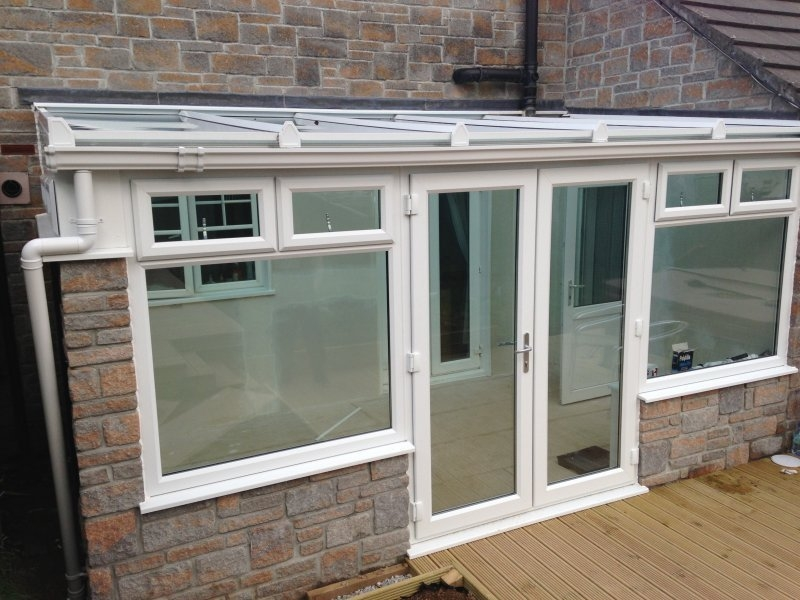 Glass Roof Lean To Conservatory With Decorative Stone Work 2