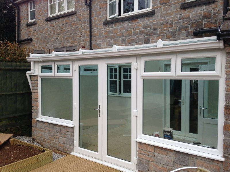 Glass Roof Lean To Conservatory With Decorative Stone Work 4
