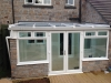 Glass Roof Lean To Conservatory With Decorative Stone Work 3