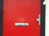 Red Composite Door With Black Frame