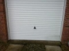 white-steel-manual-up-and-over-garage-door
