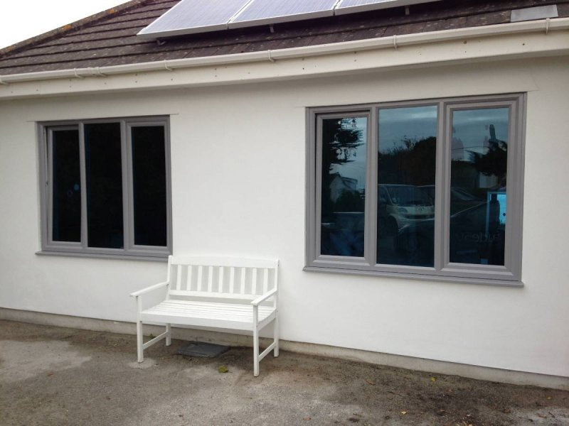 Bespoke Colur Grey PVC Window With Blue Glass