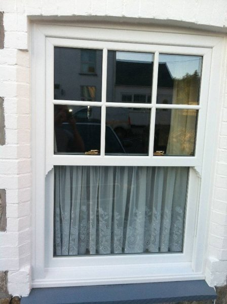 Vertical Sliding Vox Sash PVC Window With Georgian Bars To The Top Half 2