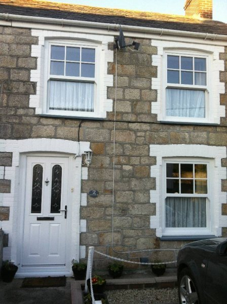 Vertical Sliding Vox Sash PVC Window With Georgian Bars To The Top Half And Composite Door